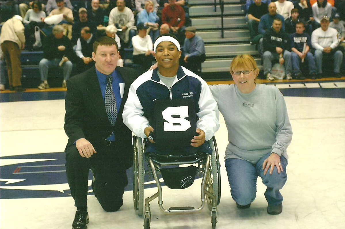 Senior day wrestling match at Penn State with my head coach Troy Sunderland and my academic advisor Sandy Meyer