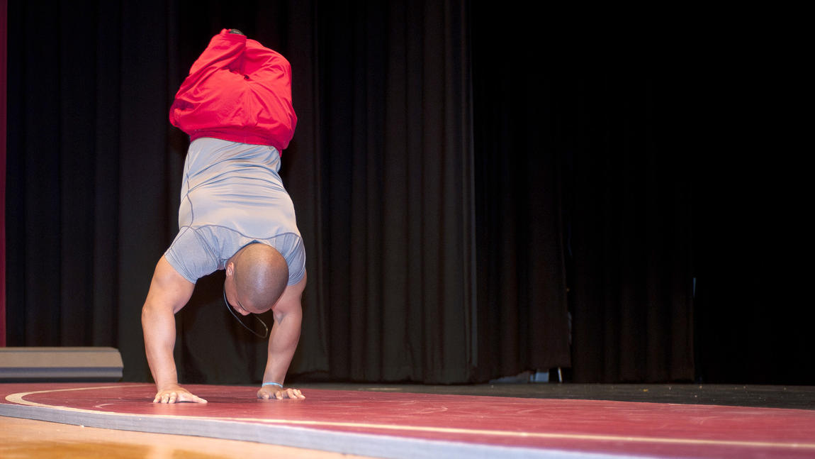 Rohan Murphy doing a hand stand while speaking